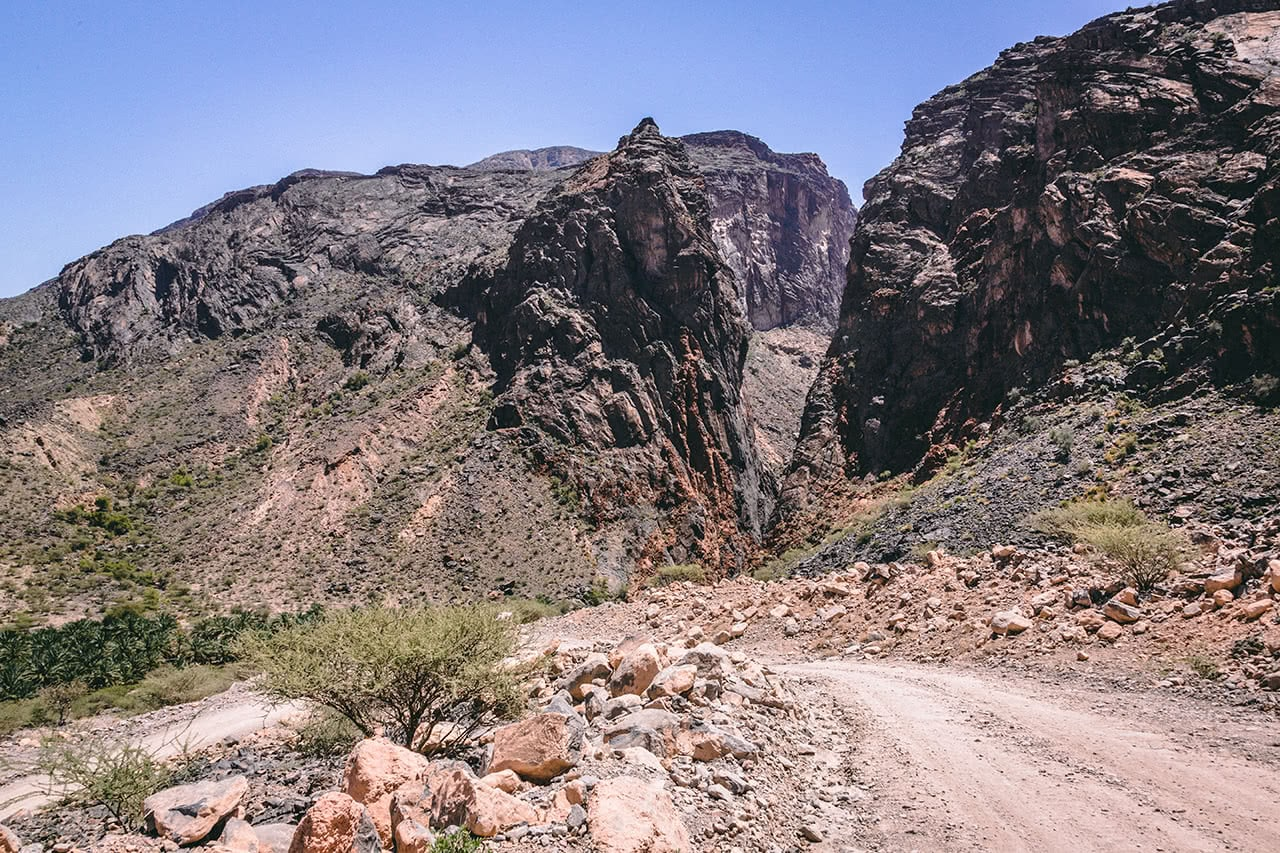 Driving through the Wadi Bani Auf in Oman.