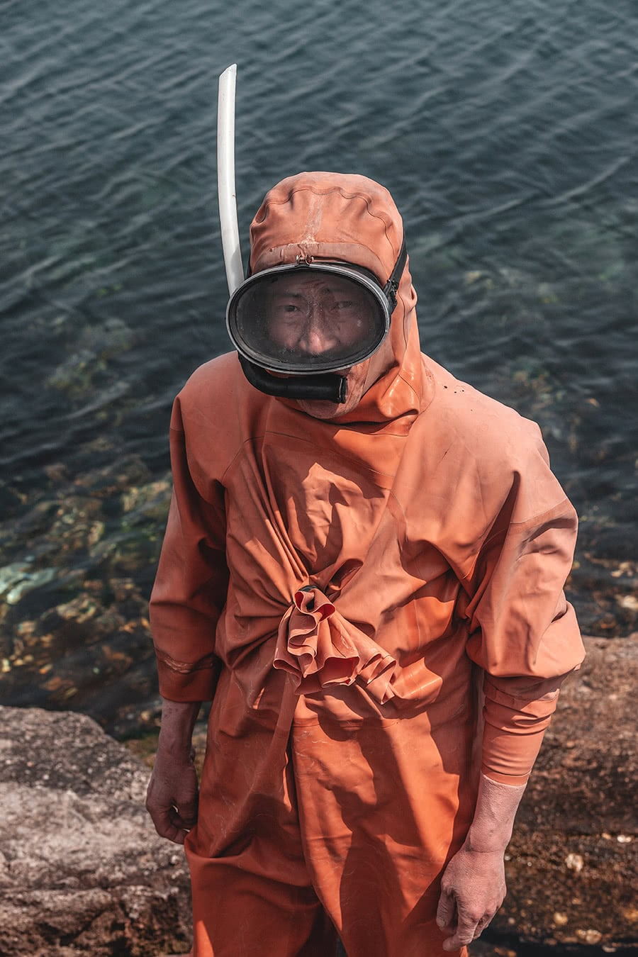 A clam farmer wearing snorkeling gear in Wonsan, North Korea.