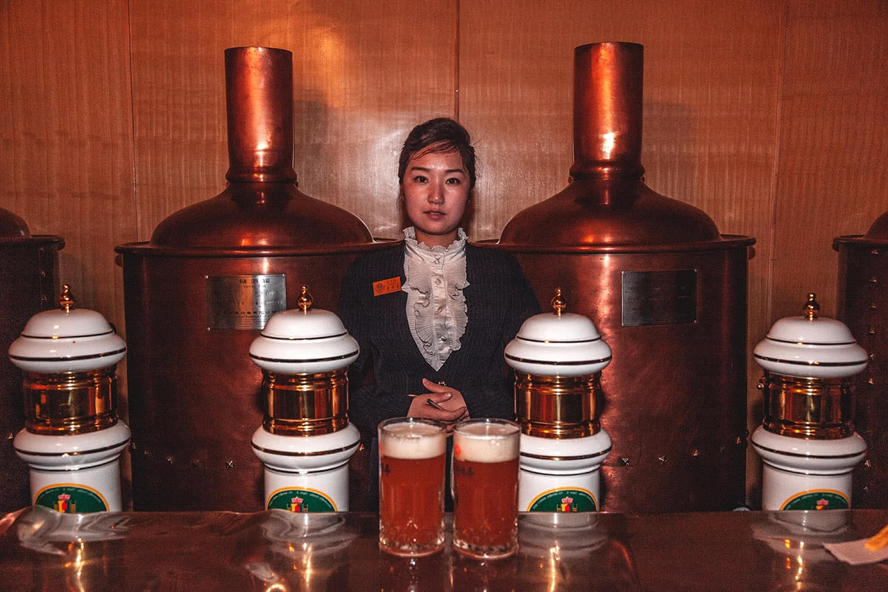 A bartender at the Paradise Beer Bar, in Pyongyang.