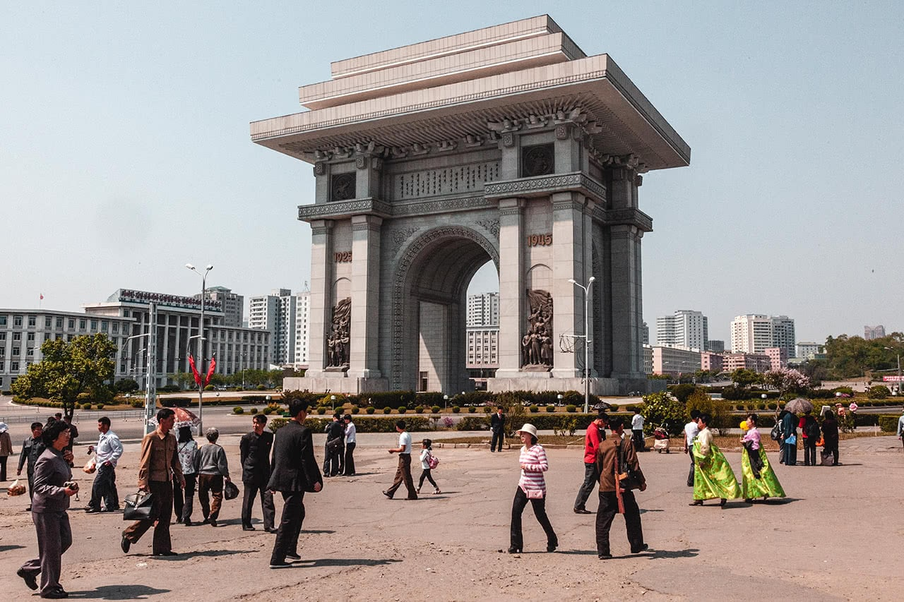 Students practicing for the Mass Games with the Pyongyang Arch of Triumph in the background.