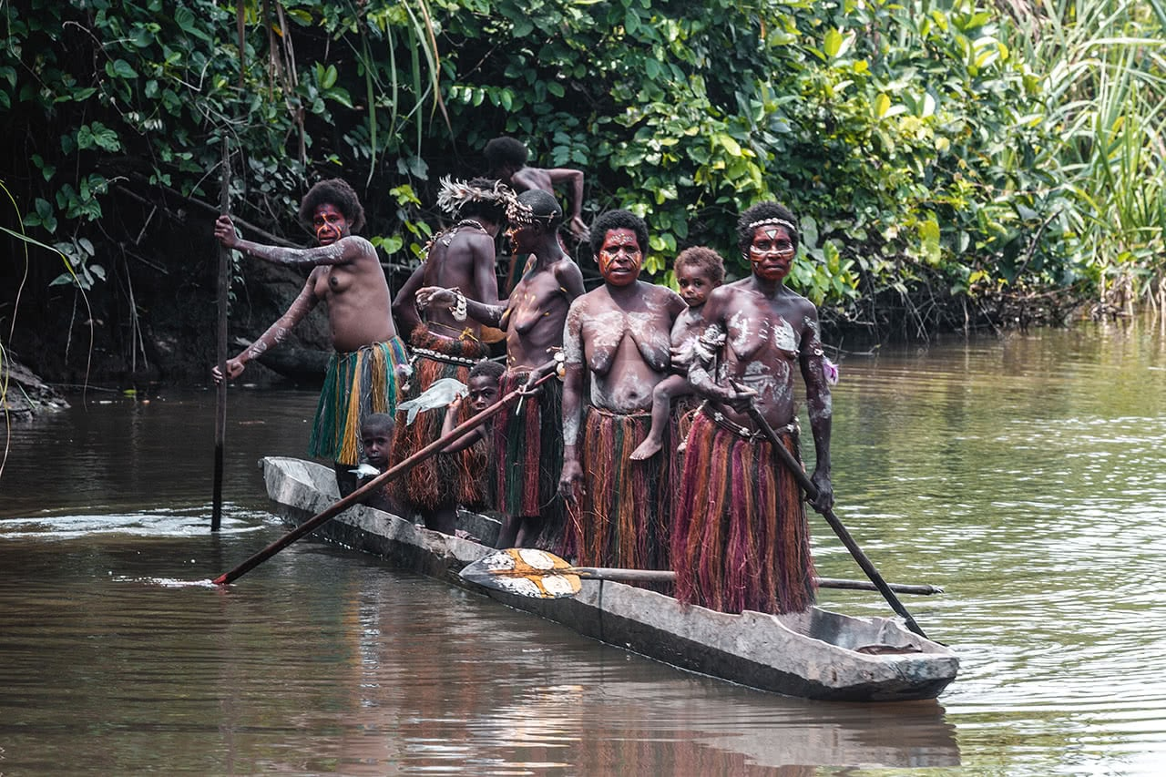 A boat full of topless women from Yimas village, Karawari, Papua New Guinea.