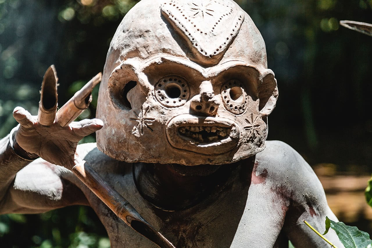"A ""mudmen"" from the Kaulga tribe, near Mount Hagen, Papua New Guinea wearing a fearsome mask."
