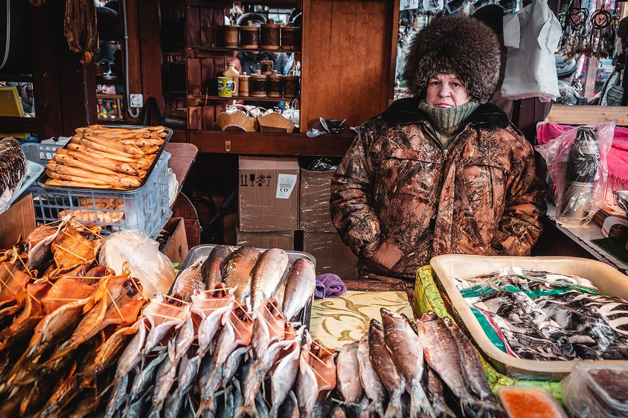 A vendor selling fish in Listvyanka, near the shores of Lake Baikal.