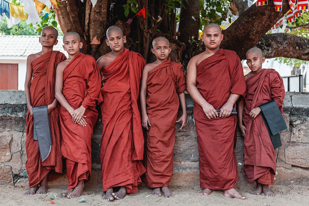 Monks posing at Sri Maha Bodhi in Anuradhapura, Sri Lanka