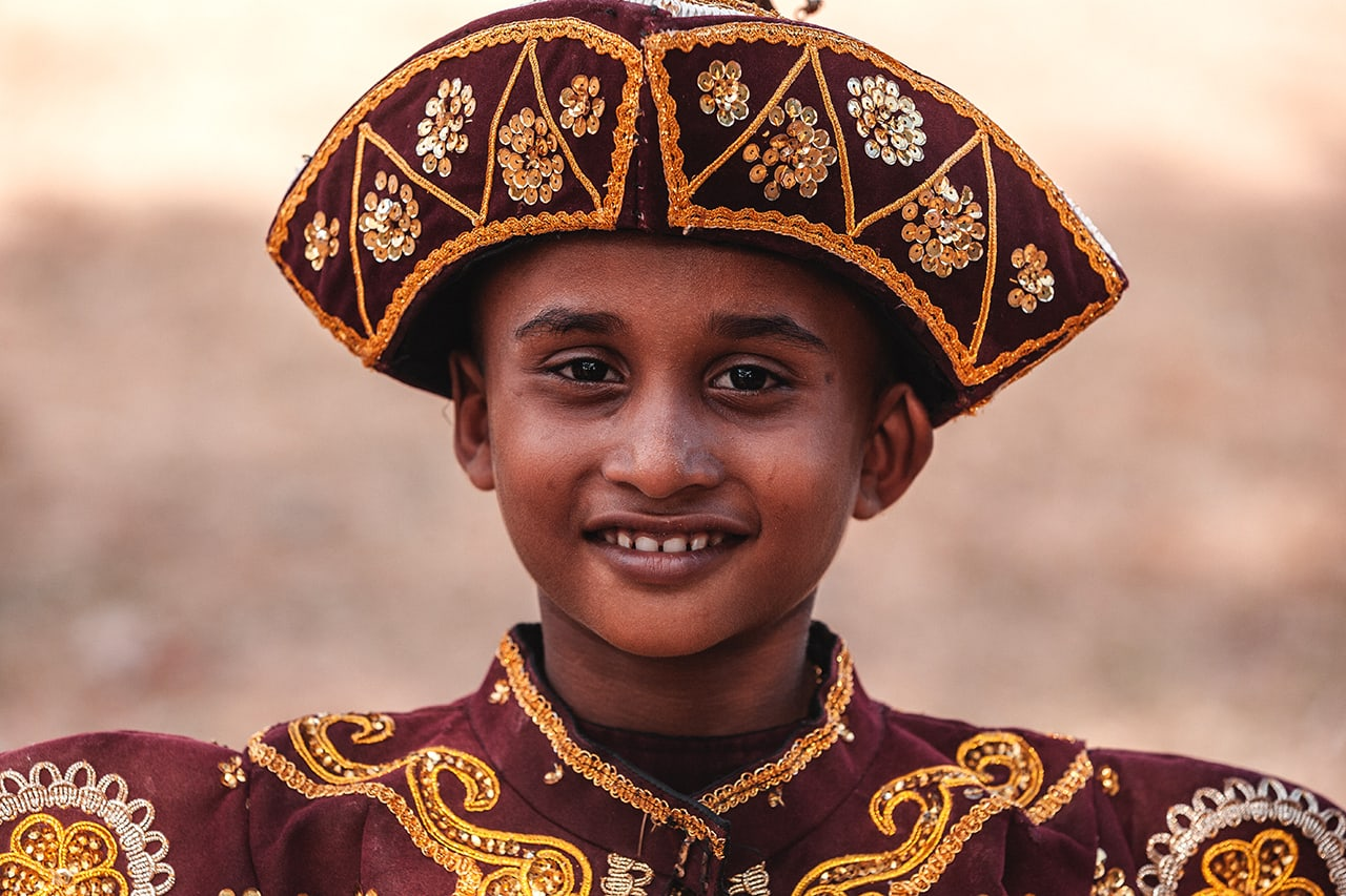 A boy dressed for a wedding party in traditional Sinhalese clothing.