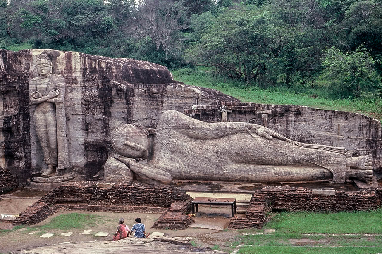 Stone buddha statues at the ancient city of Polonnaruwa, Sri Lanka.