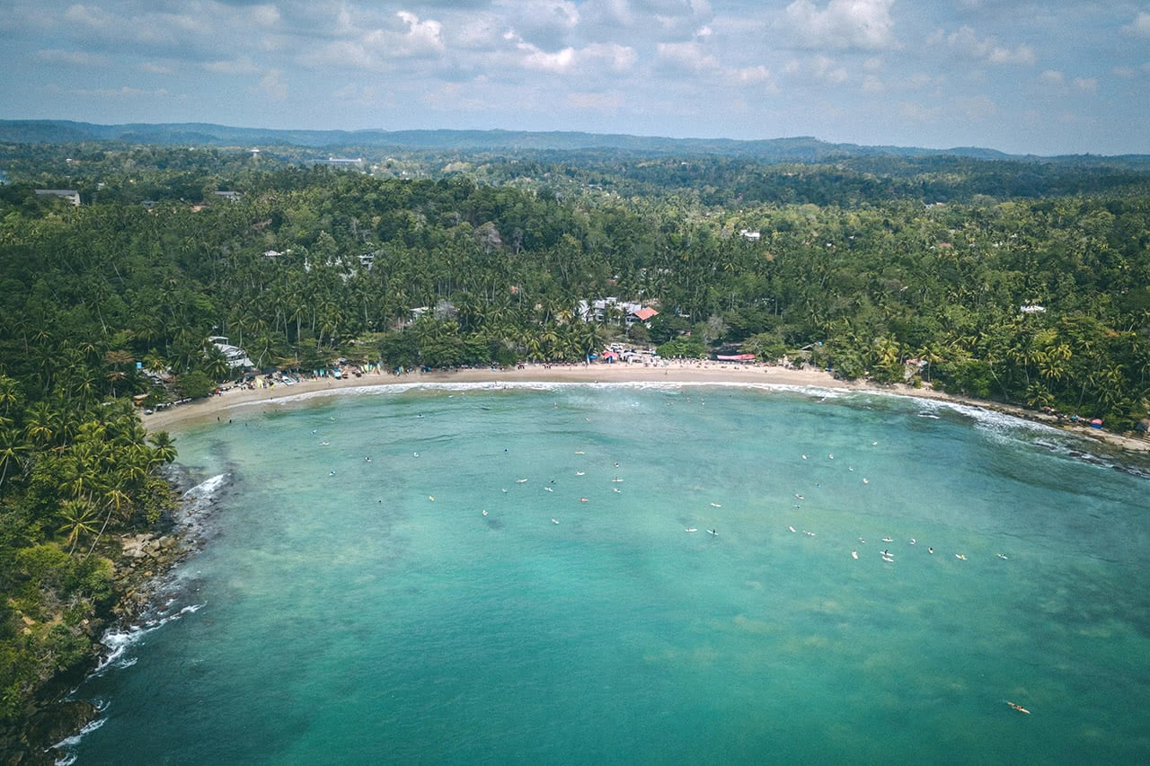 Drone view of Mirissa beach, a popular surf spot on Sri Lanka's southern coast.