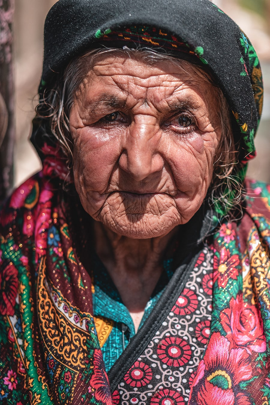 Portrait of an old Tajik woman at Jelondy Hot Springs, along the Pamir Highway.