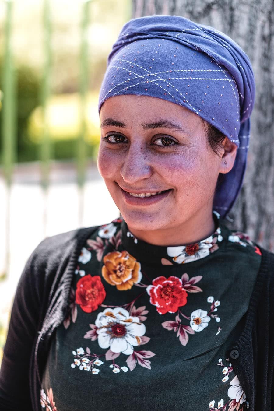 A Tajik woman at the Jelondy Hot Springs, a popular stop along the Pamir Highway.