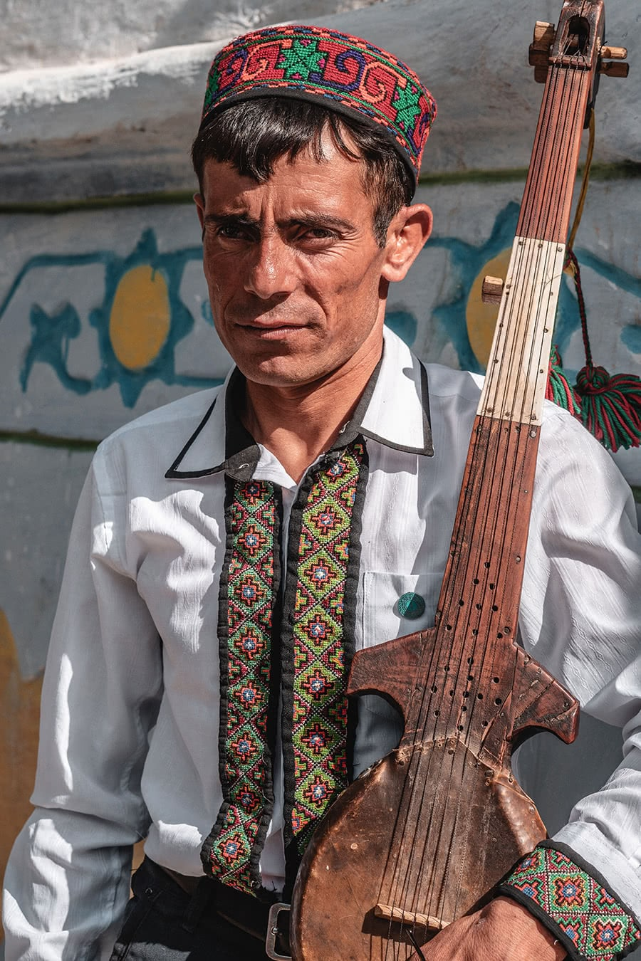 Wakhi man with traditional stringed instrument in the Wakhan Valley, Tajikistan a popular stop on the Pamir Highway.