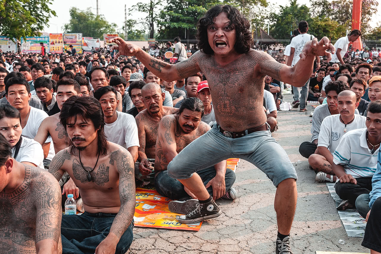 An entranced devotee comes alive at the tattoo festival of Wat Bang Phra, Thailand.