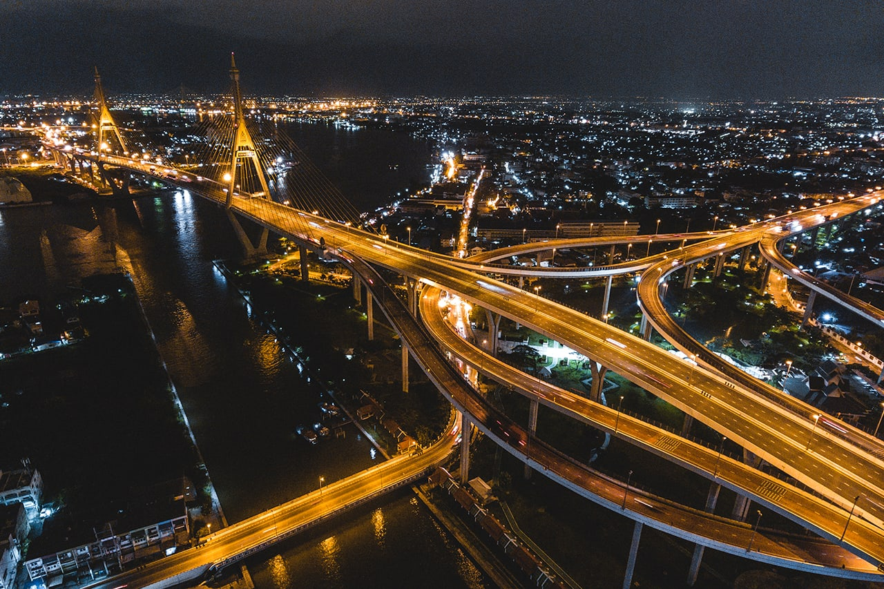 Drone photo of the Bhumibol Bridge in Bangkok at night.