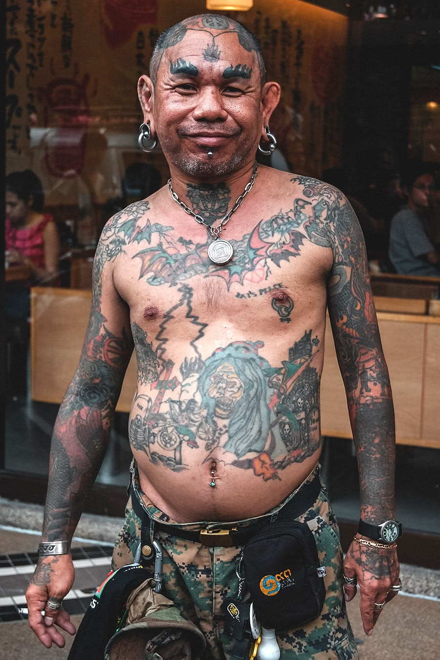 Man at a tattoo festival in Bangkok.