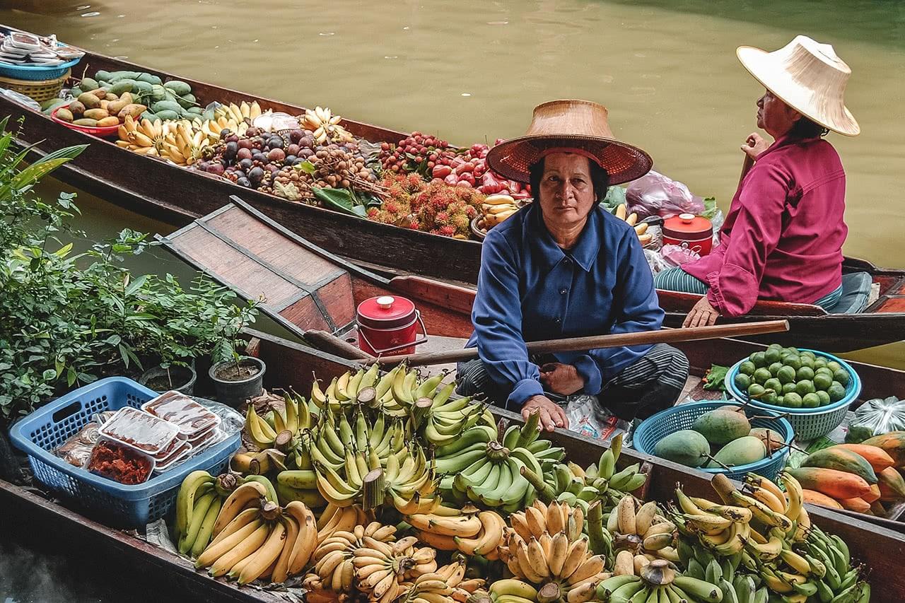 A vendor at Taka floating market, Thailand.