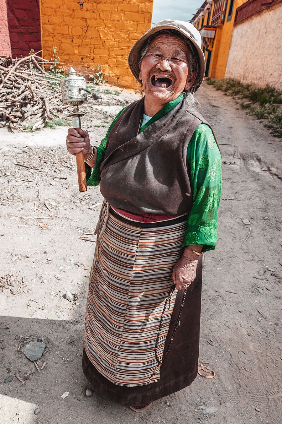 A friendly old Tibetan woman with two teeth great us.