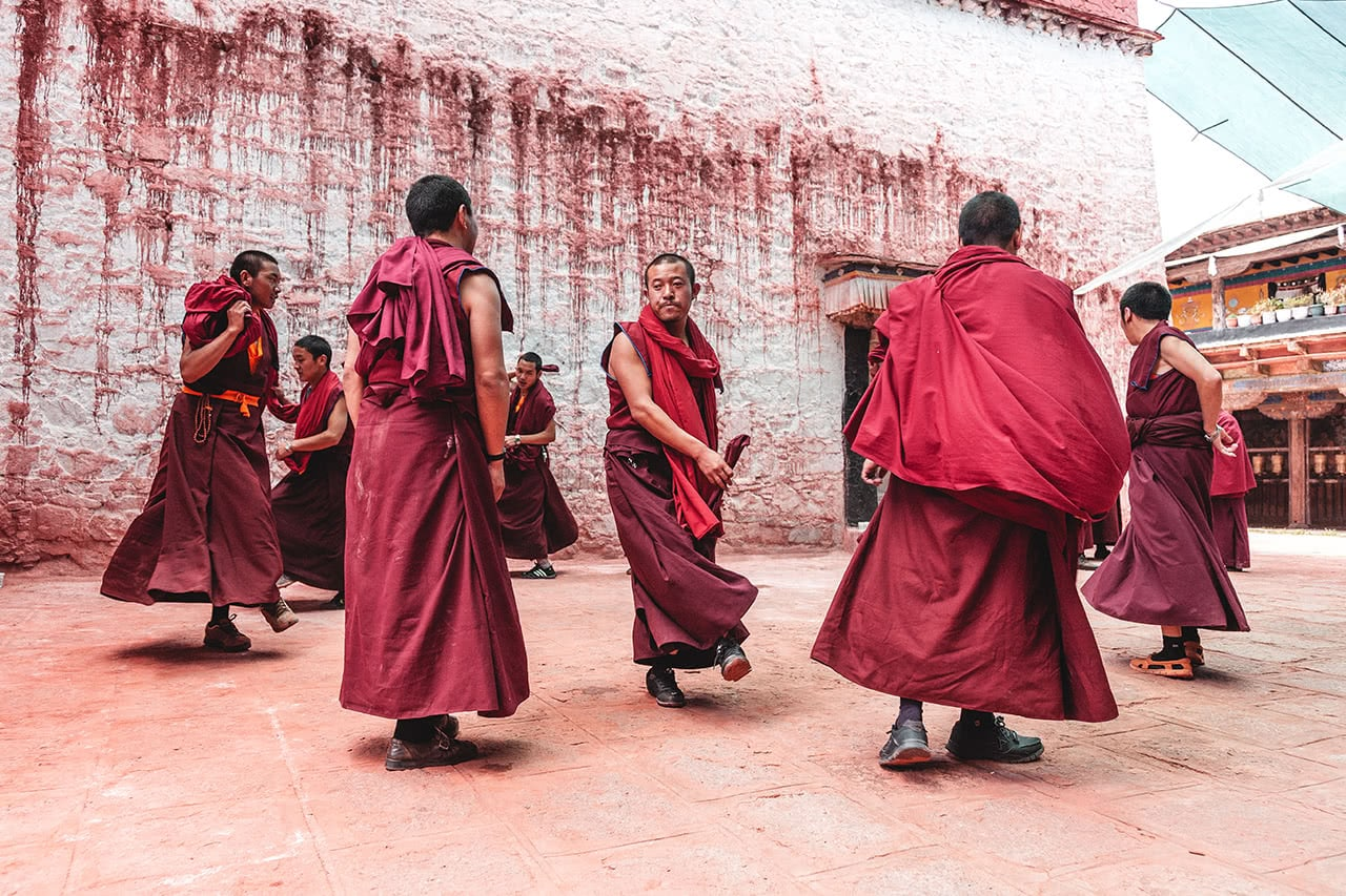 A group of monk practicing a dance at Samye Monastery in Tibet.