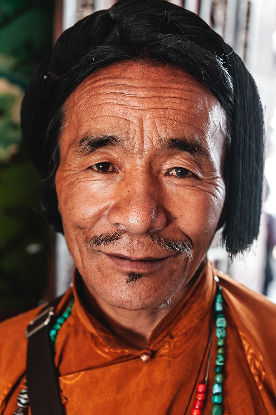 Portrait of a man from the Kham region of Tibet.