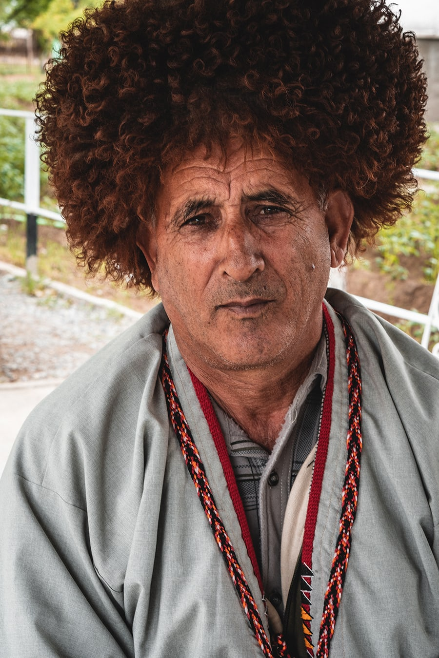 A Turkmen man wearing a traditional hat known as a Telpak.