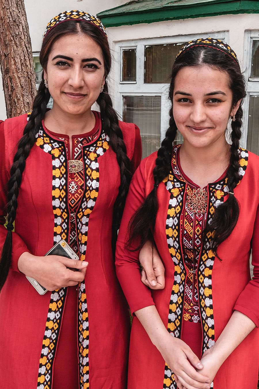 Two female students wearing traditional Turkmen dress.