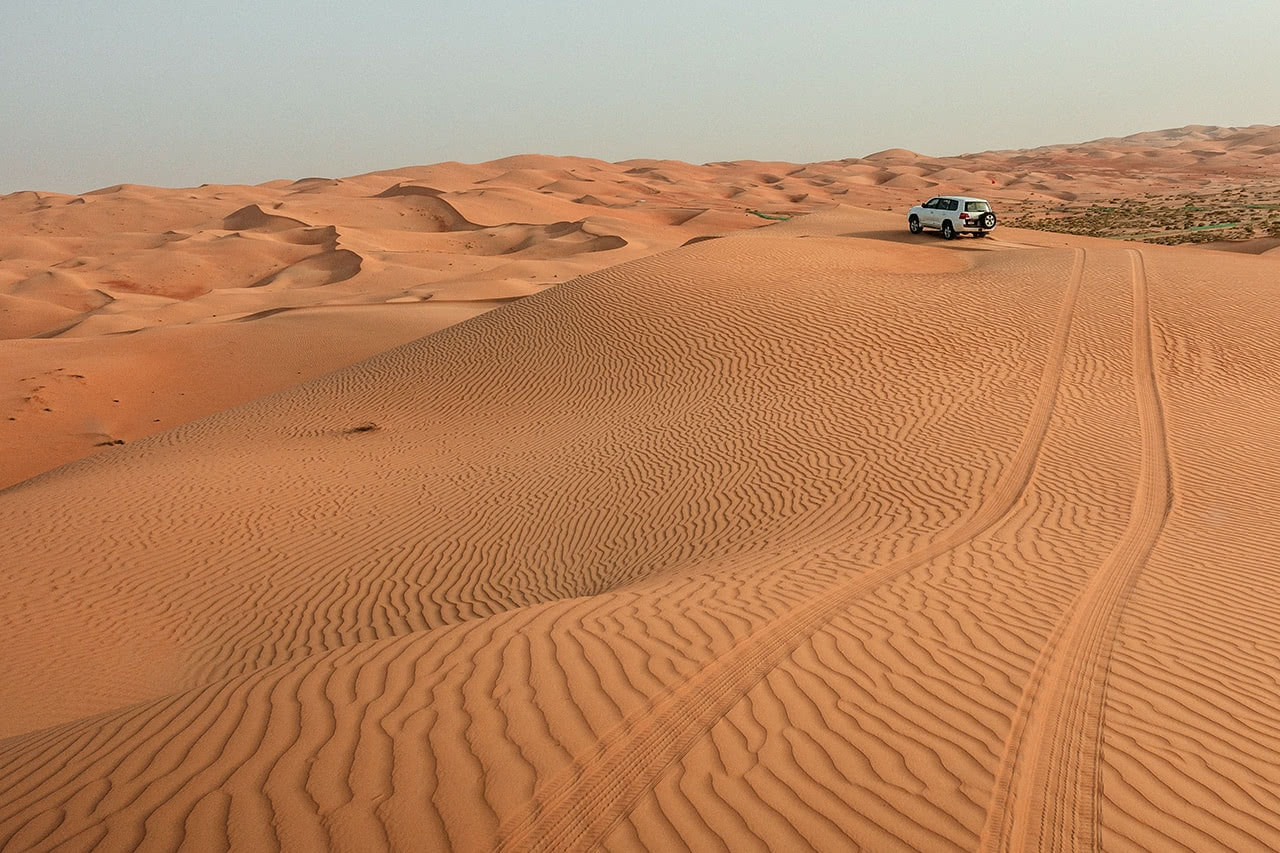 Dune bashing in the Rub' Al Khali desert.