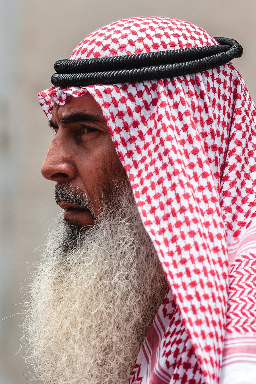 An Emirati man walking through the Al Ain market.