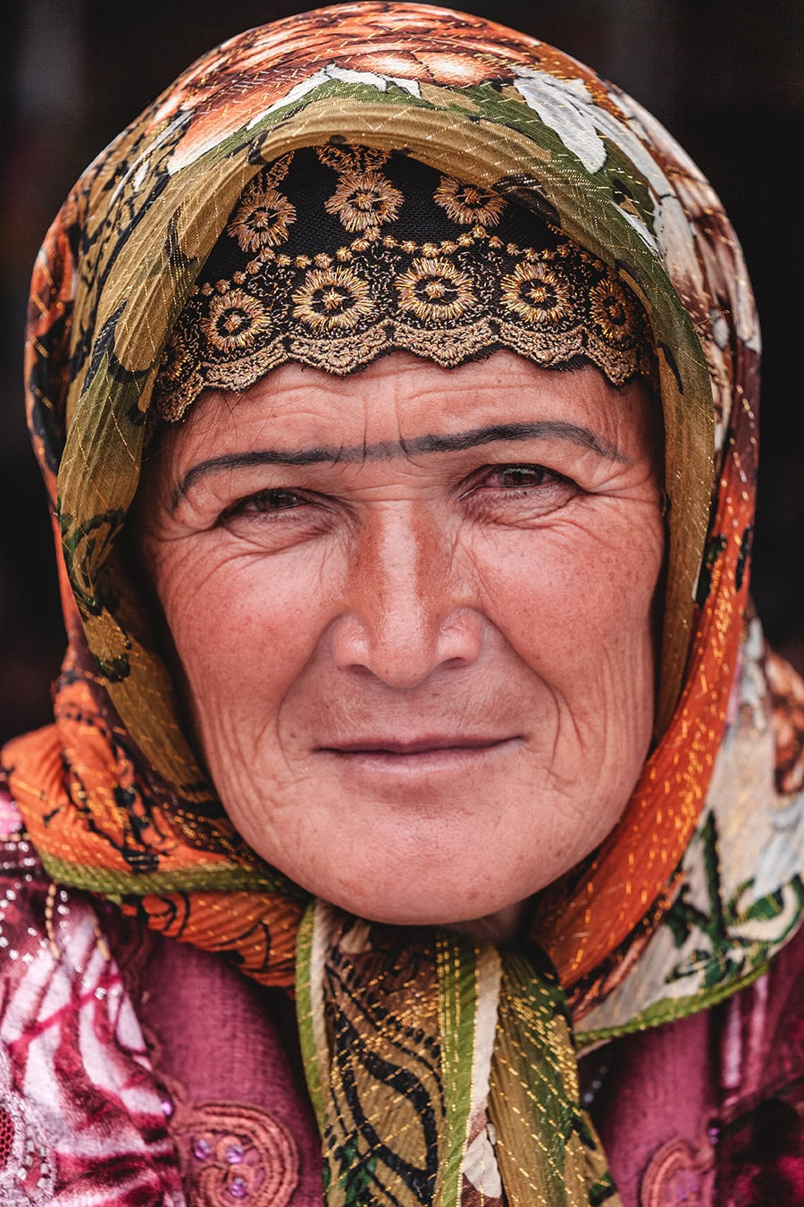 Colorful woman at the Samarkand market.