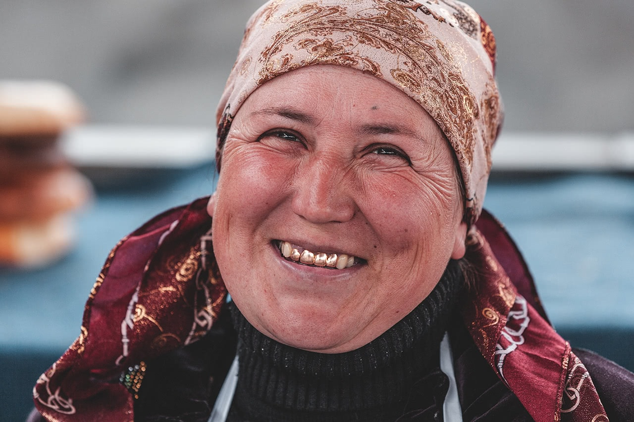 This vendor at the Samarkand market smiles with her golden teeth, common in Uzbekistan.