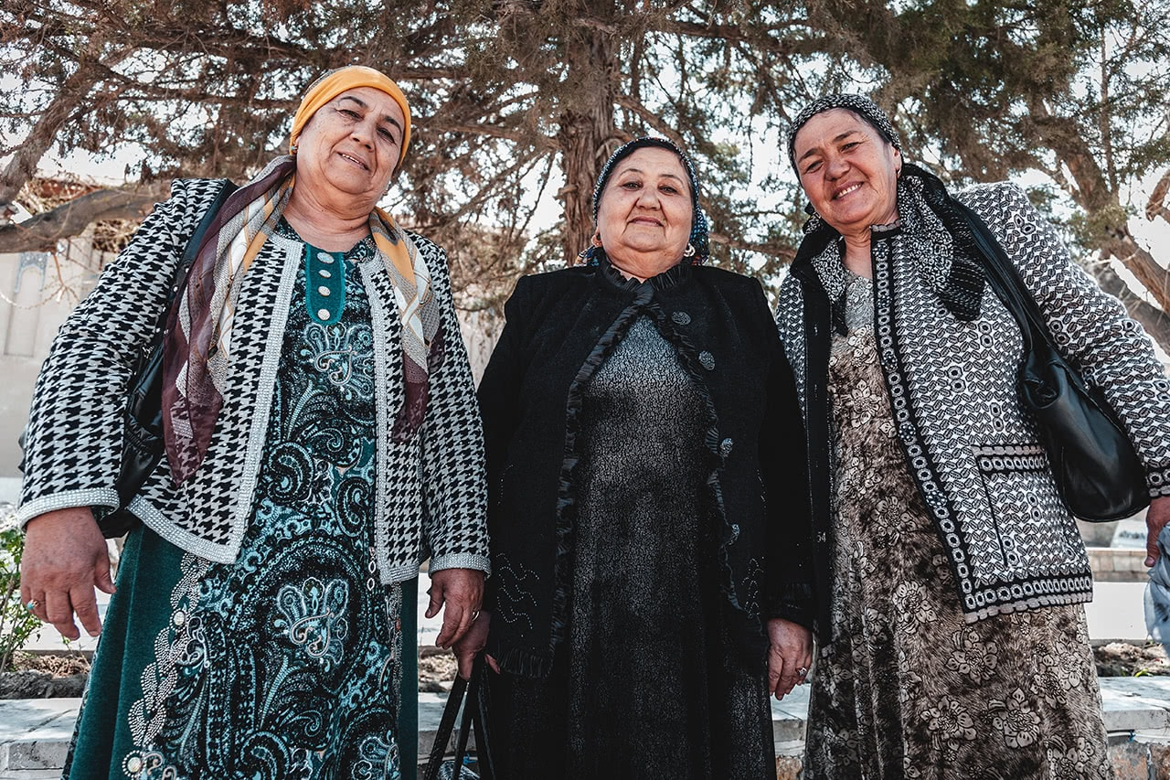 Women from the Fergana Valley pose for photos while visiting Bukhara.