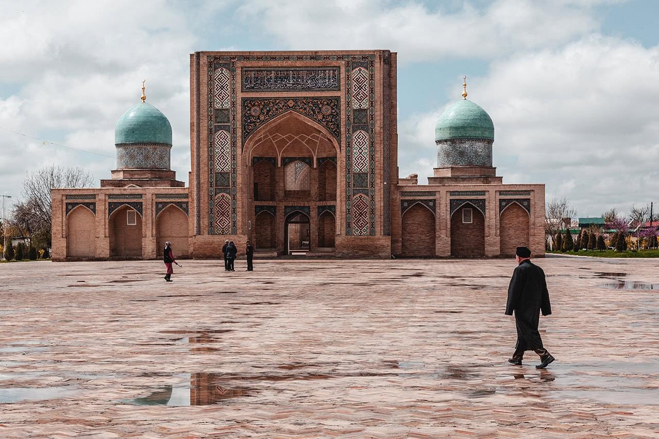 A man walks by the Khast Imam Complex in Tashkent, Uzbekistan.