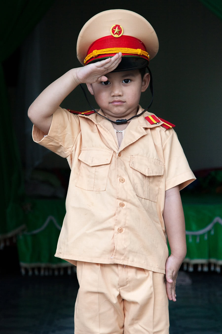 Young boy dressed as a policeman in Meo Vac.