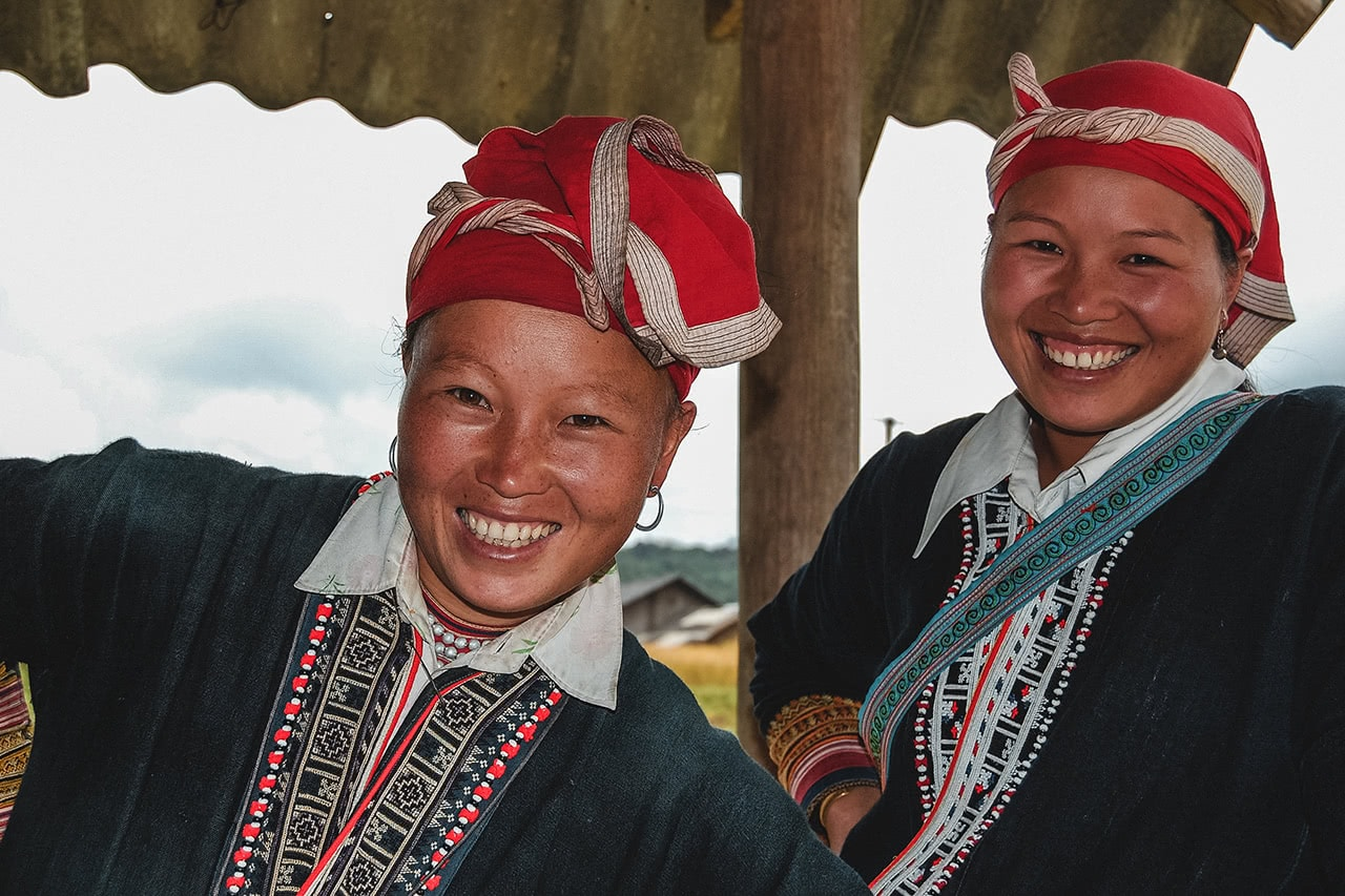 Smiling Red Dao women in Ta Phin village, Sapa.