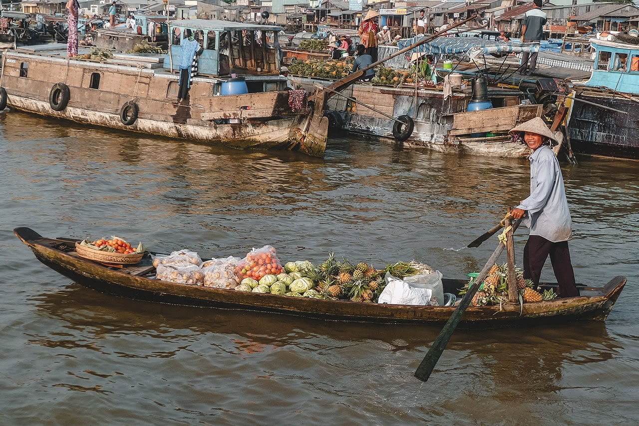 A floating vendor at Cai Rang market in the Mekong Delta